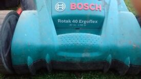 Bosh lawnmower good working order with gras ups collection box .