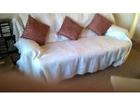 Luxury 3 seater sofa with washable fitted covers, cushions and quality white throw.