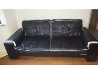 Selling two beautiful black leather sofas and footstool