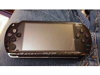 Sony Psp 1004 with a selection of games