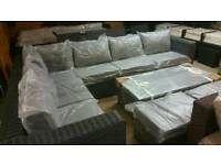 A brand new large grey garden rattan furniture set.