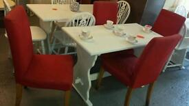 Table plus 4 red ikea chairs .