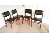 Four wood and vinyl chairs, 1960s style