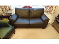 Leather two seater sofabed. Hardly used - £150