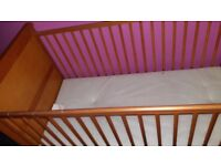 A Beautiful Wooden Light Brown Colour cot/ Toddler first bed.