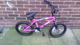 girls bike .pink and black aged 5 to 10,been used once.amaculate condition.