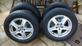 """Set of four used 15"""" Skoda 5 stud Alloy Wheels with 3 winter tyres."""