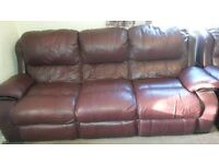 Burgundy leather three piece suite (3 seater and 2 chairs)