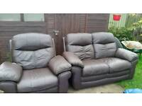 Beautiful solid brown leather settee with recliner chair