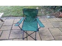 Red and green foldable lightweight camping chairs with cupholders