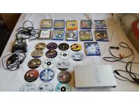 PS2 WITH 28 GAMES AND EYE TOY.