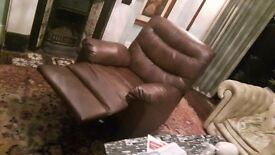 Faux leather armchair, 'feet up' function and fully reclining (almost new)