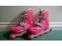 Slightly worn size 2.5 roller skates