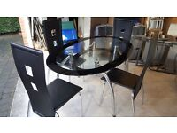 Oval glass topped dining table and 4 chairs