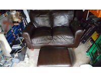 Brown 2 seater leather Sofa £40.00 ovno plus footstool Good Condition Very Comfortable
