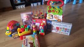 Baby and toddler toys in perfect condition, brand new baby-doll, puzzles, shape games, baby walker,