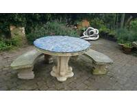solid stone garden table