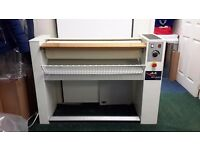 Ironing roller machine, ideal for nursing homes or any small laundry business.