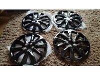 """15"""" wheel trims in gloss black,never been used,unwanted present for my sons 1st car"""