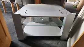 Grey TV stand with glass shelf