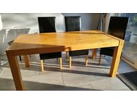 SOLID OAK TABLE . PLUS CHAIRS.