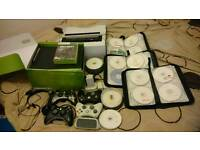 Xbox 360 with over 170 games and kinect plus lots of extras..