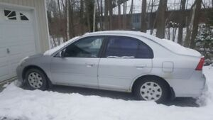 FOR SALE: 2004 Honda Civic comes with snows