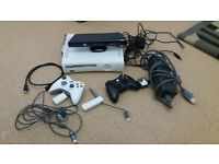 XBox 360 (20gb) with Kinnect, 2 controllers, wifi dongle and 15 games