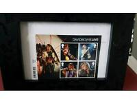 David bowie 1st editions day stamps framed.