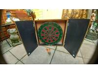 Dartboard and cabinet