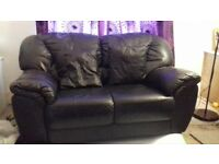 3 seater and 2 seater matching black leather couches in good condition.