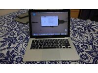 2Yr Old Mac book pro in very good condition with nice cover i5 16 gb RAM 512 HDD