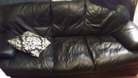 3 seater black leather sofa. Great condition £25.only