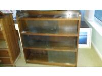 solid wood cabinet with 4 shelves and glass sliding doors