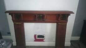 Attractive Edwardian Wood Fire Surround. Inlaid Green tiles and Gold decoration.