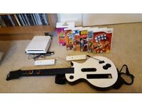 Nintendo Wii Bundle including console, games, 2x controllers and guitar adaptor.