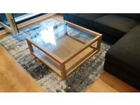 Glass top and wooden frame coffee table