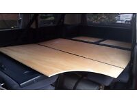 VW T4 Caravelle rear seats complete with folding bed conversion.