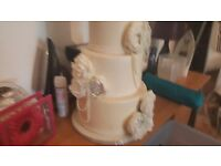 4 tier iced fake wedding cake