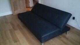 black faux leather click-clack sofa bed