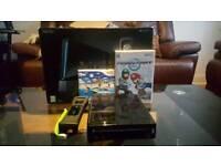 Nintendo Wii Black With Wii Sport Resort And Mario Kart Bundle
