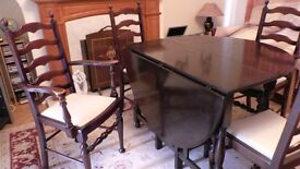 Mahogany oval drop leaf dining table and four chairs