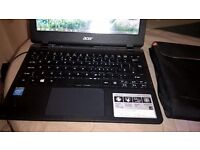 ACER ASPIRE E11-NETBOOK. 18months old used a couple of times unwanted gift . still boxed with pouch