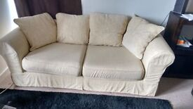Cream coloured 3 seater couch from NEXT.