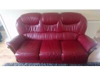 Beautiful burgandy leather sofa in excellent quality. 3 seater and 2 single armchairs included.