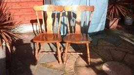 TWO SOLID HARDWOOD KITCHEN/DINING CHAIRS WITH VERY ATTRACTIVE HAND-CARVED DESIGN ON BACKRESTS
