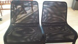 A PAIR OF BLACK COLOURED COMFORTABLE CHAIRS
