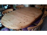 extending pine dining room table with 6 chairs. good condition. no pets. non smokers