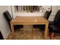Extendable wooden dining table with leather chair