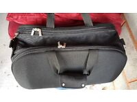 2 trolley suitcases for sale